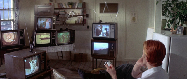 Fig 2 THe Man Who Fell To Earth watches TV